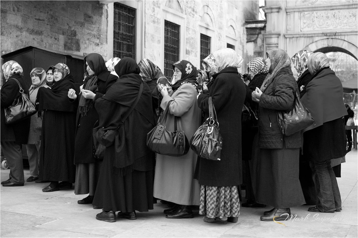 Weomen pray at a Mosque in Istanbul
