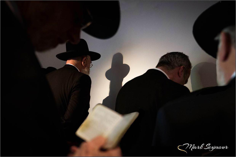 Jewish men praying before the wedding ceremony photographed by Berkshire Wedding Photographer Mark Seymour
