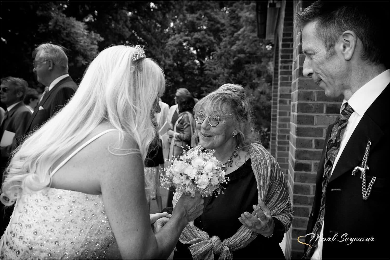 bride mingles outside church