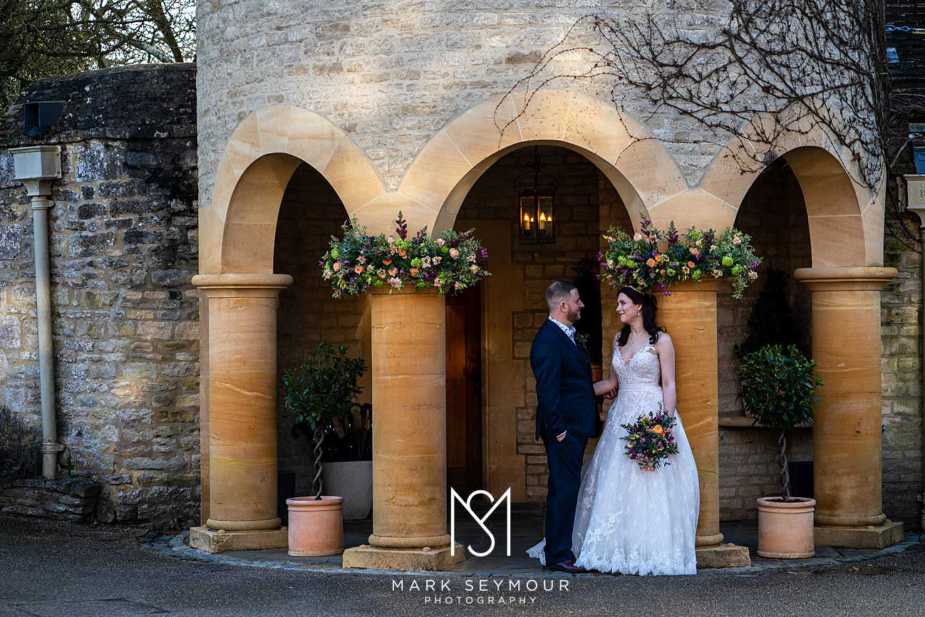 Bride and groom pose at Le Manoir