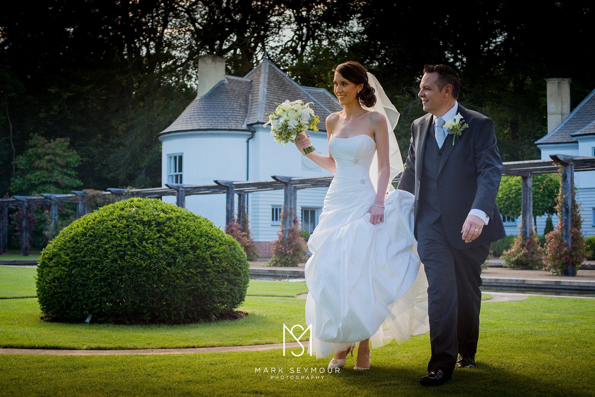 Bride and groom walking at The Limewood Hotel