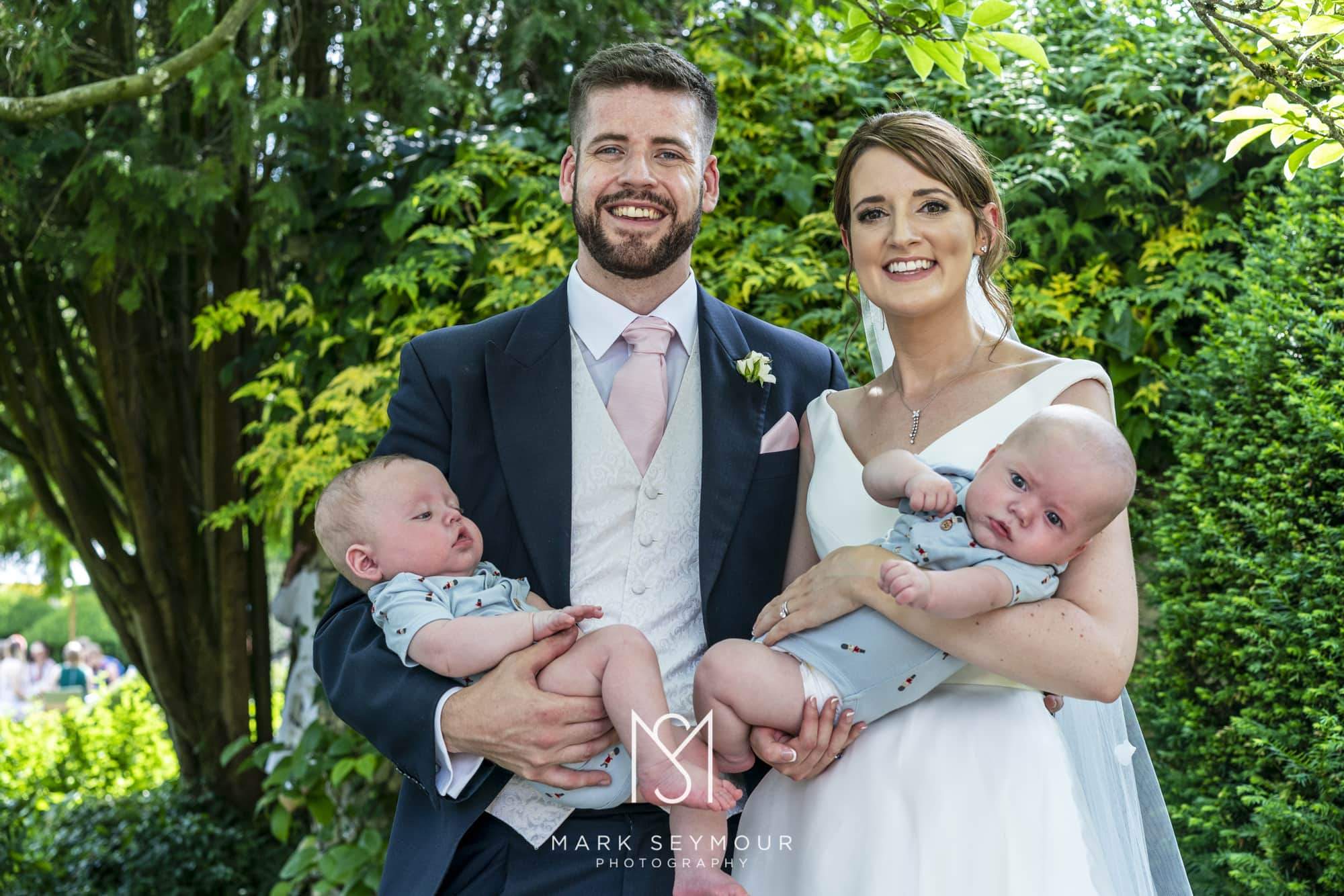 Bride and groom with babies
