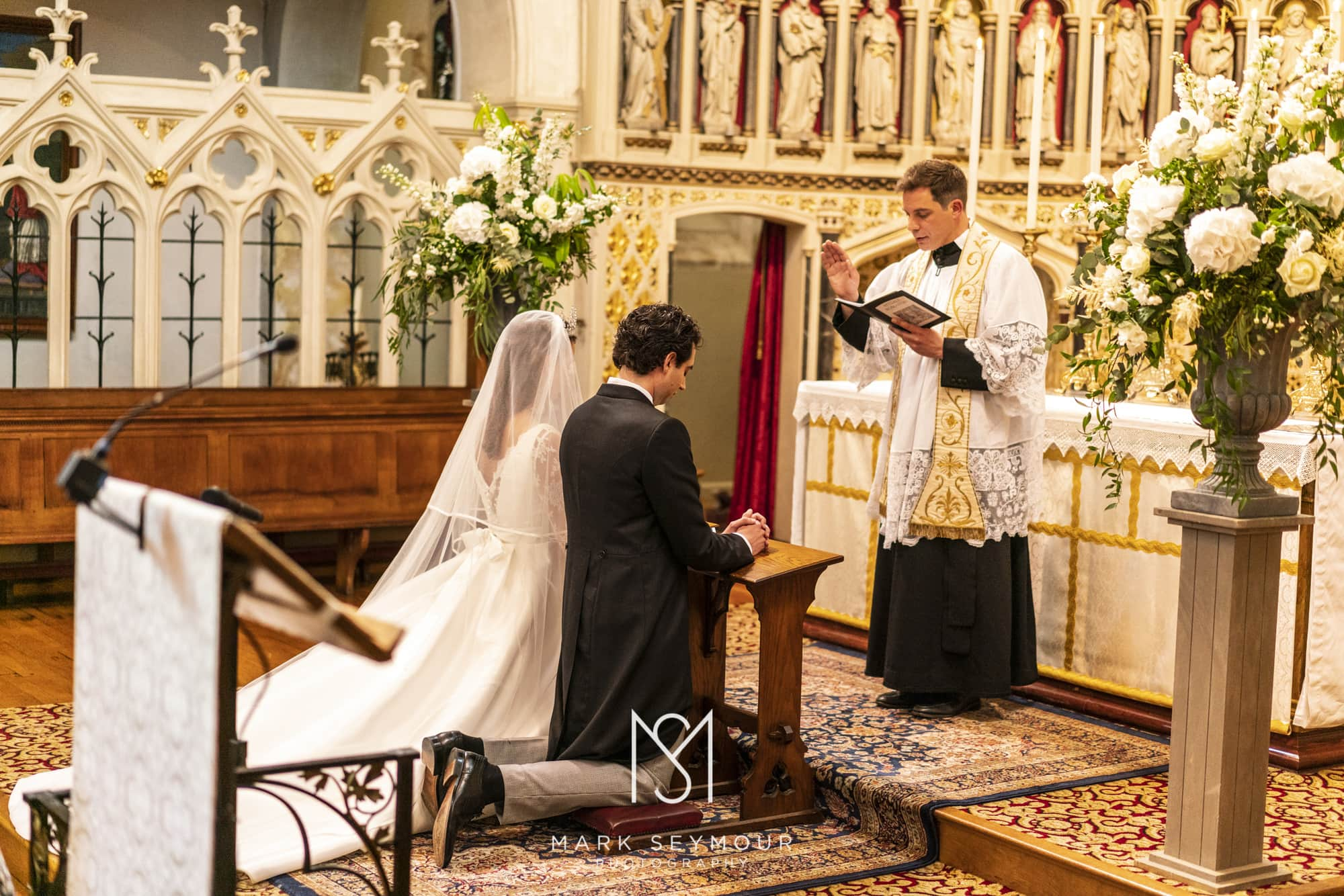 Bride and groom with vicar