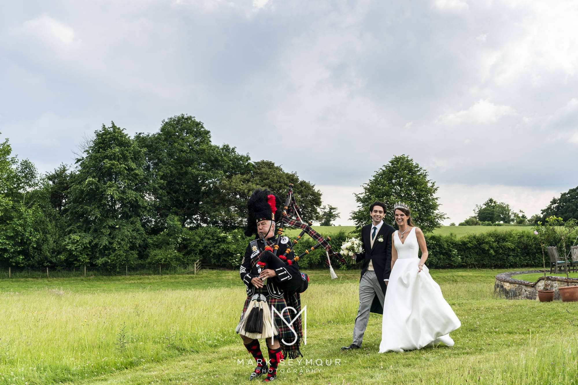 Bride and groom with Bagpipe player